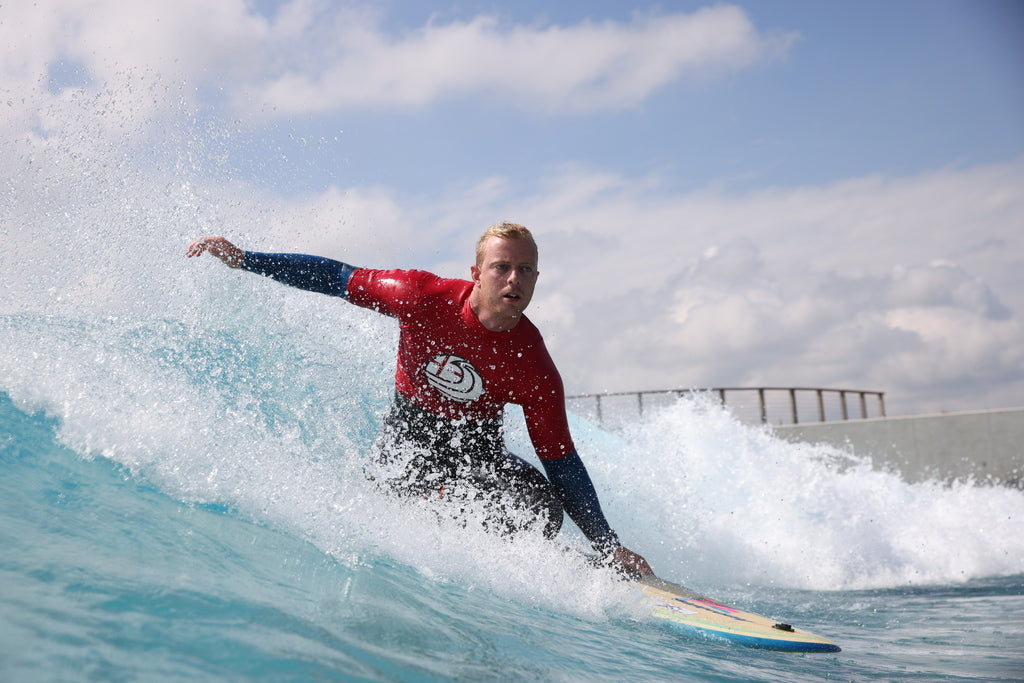 Adaptive surfer competing at the 2021 dryrobe English Adaptive Surfing Open