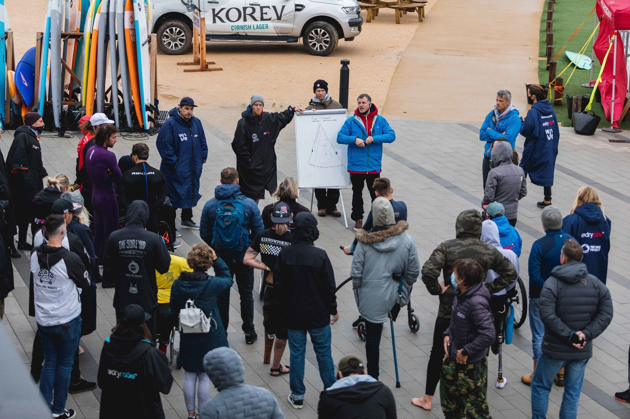 Competitors outdoors being briefed about The Wave at the 2020 English Adaptive Surf Open