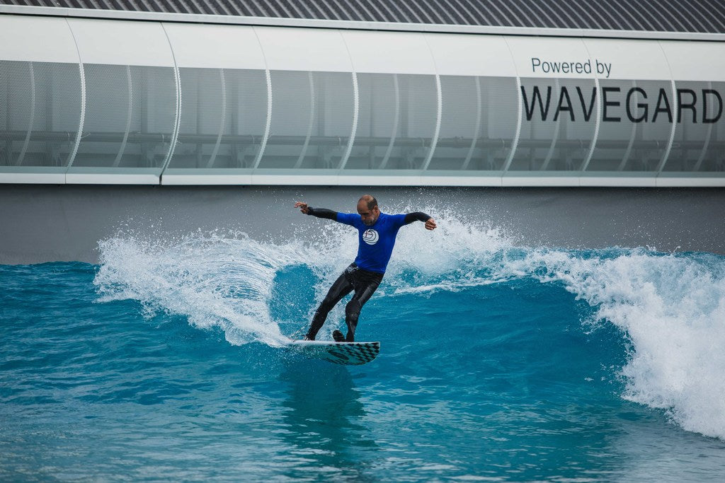 Surfer competing at 2021 dryrobe English Adaptive Surfing Open