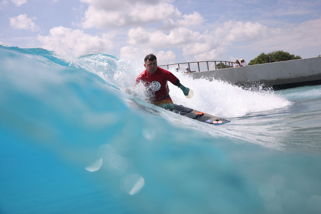 Adaptive surfer competing at The wave