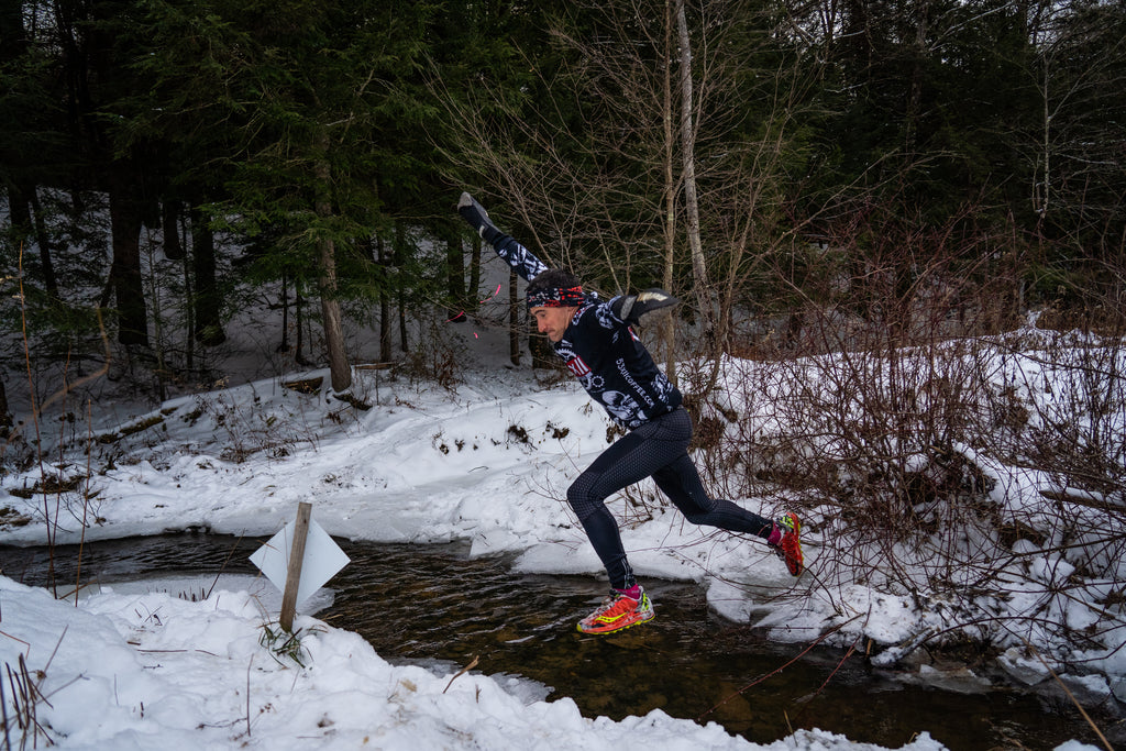 Evan Perperis - Jumping over a stream during OCR America 2