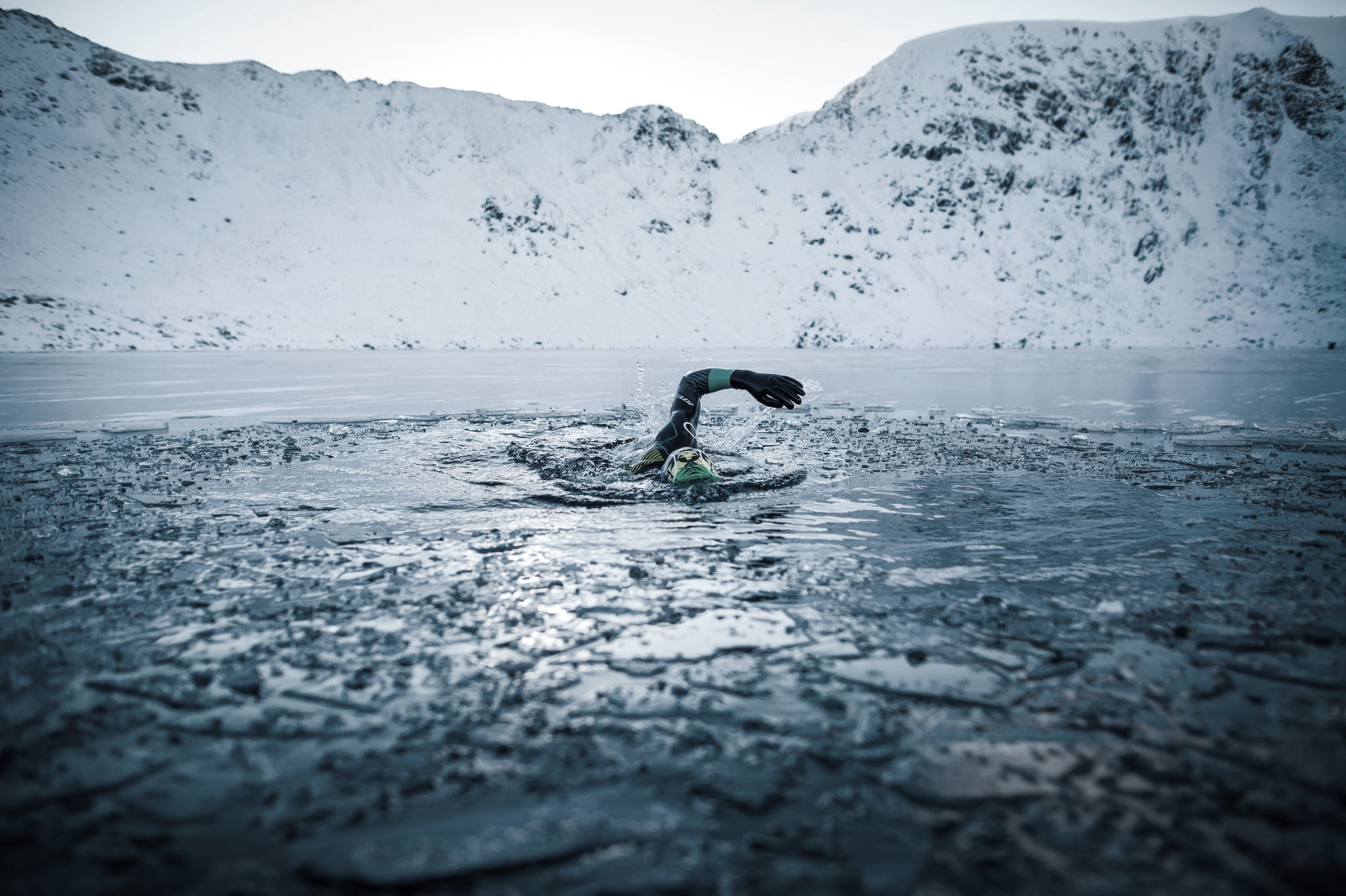 Jacob Tonkin swimming through the ice at at Red Tarn