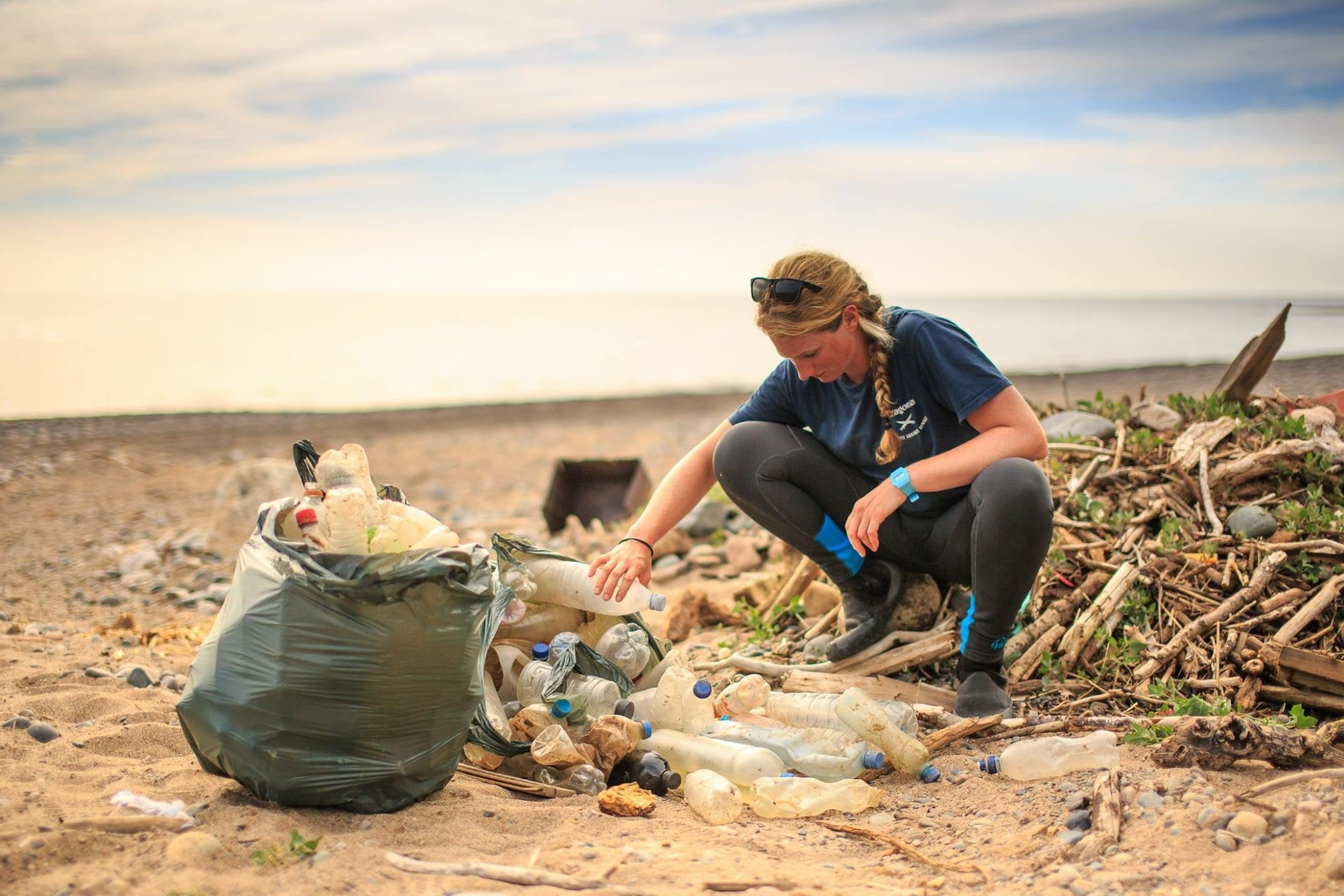 Cal Major collecting plastic waste from the beach