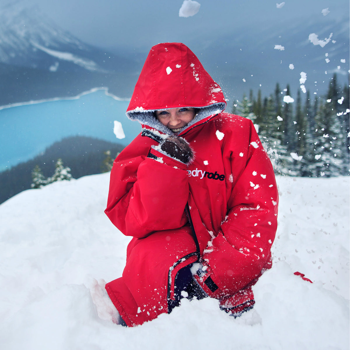 1| dryrobe Advance Long Sleeve Red Grey Female in Snow Lifestyle Image