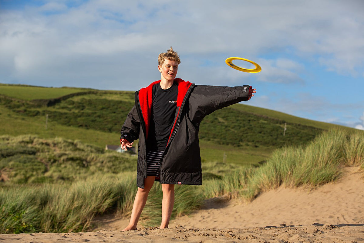 Kids dryrobe Advance Long Sleeve Child Playing with Frisbee