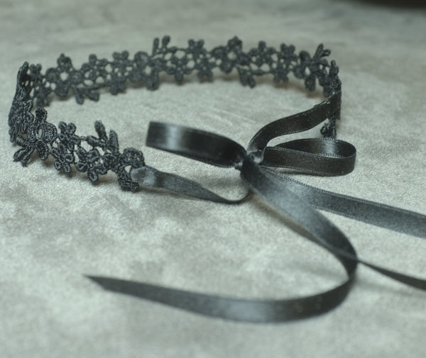 black choker with satin ribbon