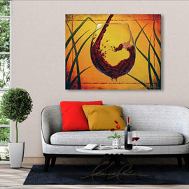 Leanne Laine Fine Art original artist painting displayed above couch of beautiful woman in red wine glass with yellow background