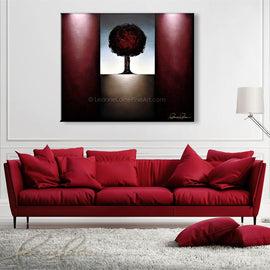 Leanne Laine Fine Art original artist painting displayed above couch of red tree in nature autumn landscape