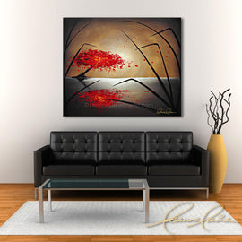 Leanne Laine Fine Art original artist painting displayed above couch of red tree blowing autumn leaves over water