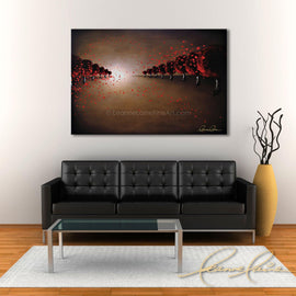 Leanne Laine Fine Art original artist painting displayed above couch of red trees blowing autumn leaves in windy nature