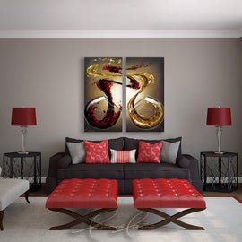 Leanne Laine Fine Art original artist painting displayed above couch  of two large wine glasses pouring and splashing red and white wine