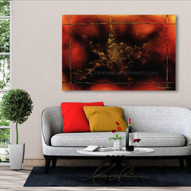 Leanne Laine Fine Art painting displayed above couch of abstract gold star against red and yellow background