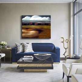 Leanne Laine Fine Art painting displayed above blue couch of windy day with flag blowing at the golf course by the water