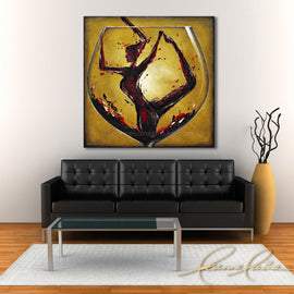 Leanne Laine Fine Art painting displayed above black couch of woman in yoga pose in red wine pouring into a big wine glass