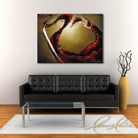 Leanne Laine Fine Art original artist painting displayed above couch of woman in wine in red glass swirling