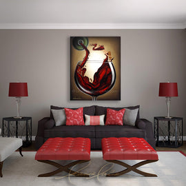 Leanne Laine Fine Art original artist painting displayed above couch of splashing red woman in wine glass holding cork pouring from bottle
