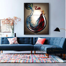 Leanne Laine Fine Art original artist painting displayed above couch of splashing red woman in wine glass holding cork pouring from water bottle