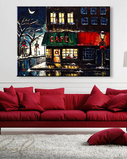 Leanne Laine Fine Art painting displayed above couch of Christmas winter cafe scene of couple drinking warm coffee