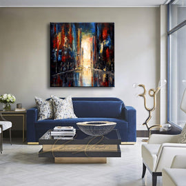 Leanne Laine Fine Art original artist painting displayed above couch of downtown city at night with cars and saxophone player