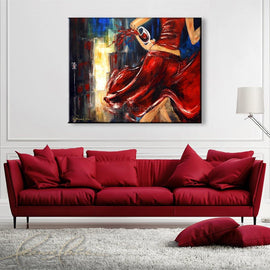 Leanne Laine Fine Art original artist painting displayed above couch of red wine glass spilling into city street from woman in red dress
