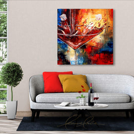 Leanne Laine Fine Art original artist painting displayed above couch of large martini glass with ice cubes and red splashing gin vodka spirits