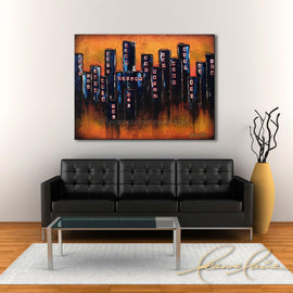 Leanne Laine Fine Art original artist painting displayed above couch of condo buildings in downtown city with sunset sky