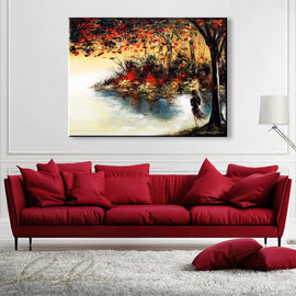Leanne Laine Fine Art original artist painting displayed above couch of red and yellow leaves in nature blowing over water with woman in dress looking out over lake