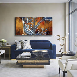 Leanne Laine Fine Art original artist painting displayed above couch of large martini glass pouring and splashing blue gin vodka spirits