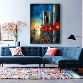 Leanne Laine Fine Art original artist painting displayed above couch of people walking on city street by water with red autumn trees reflecting on road
