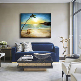 Leanne Laine Fine Art original artist painting displayed above couch of couple having wine on tropical beach under palm tree in the caribbean sea