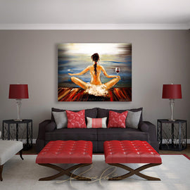 Leanne Laine Fine Art painting displayed above couch of brunette woman yogini with wine glass and butterfly meditating yoga by the water