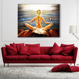 Leanne Laine Fine Art painting displayed above couch of blonde woman yogini with wine glass and butterfly meditating yoga by the water