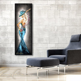 Leanne Laine Fine Art painting displayed above chair of sexy woman in hat and teal dress pouring pink wine behind back with rose in mouth