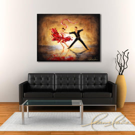 Leanne Laine Fine Art painting displayed above black couch of Man in black suit with woman in red dress and heels dancing