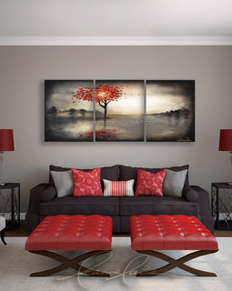 Leanne Laine Fine Art original artist painting displayed above couch of woman as a tree with red blowing autumn leaves against dark sky