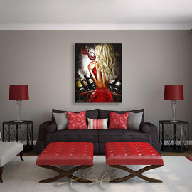 Leanne Laine Fine Art painting displayed over couch of sexy blonde woman in red dress at wine rack holding a glass of red wine