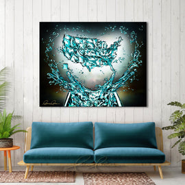 Leanne Laine Fine Art original artist painting displayed above couch of United States country glass splashing water teal turquoise with helping hands and heart