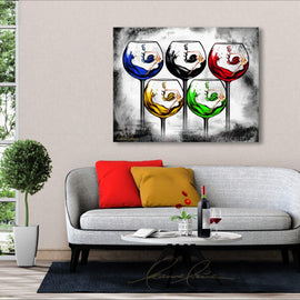 Leanne Laine Fine Art original artist painting displayed above couch of women in wine splashing and swimming in glasses like five olympic rings