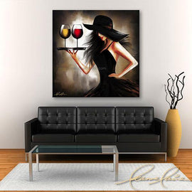 Leanne Laine Fine Art original artist painting displayed above couch of brunette sexy woman in black hat carrying tray of red and white wine