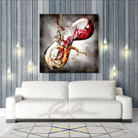 Leanne Laine Fine Art original artist painting displayed above couch of red and white wine pouring and splashing between two glasses