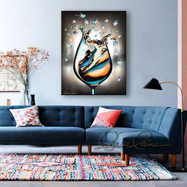 Leanne Laine Fine Art original artist painting displayed above couch of woman in teal turquoise gold wine climbing in a wine glass with sparkles and diamonds