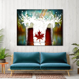 Leanne Laine Fine Art original artist painting displayed above couch of beer pouring splashing into glass frosty mug with Canada flag and Canadian leaf