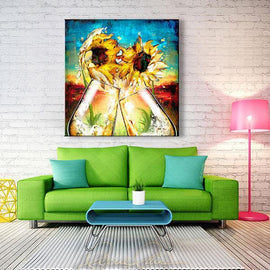 Leanne Laine Fine Art original artist painting displayed above couch of two sunflowers and champagne glasses splashing with sunset