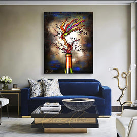 Leanne Laine Fine Art painting displayed above couch of sexy woman flower pouring out of wine bottle in red blue purple and yellow petals