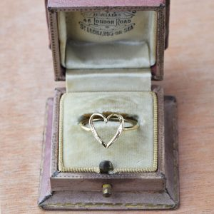 The small gold heart ring in gold would make the perfect gift for her