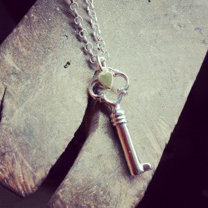 The first item in the 'FOUND' collection. Sterling silver key with a tiny 9ct gold heart.