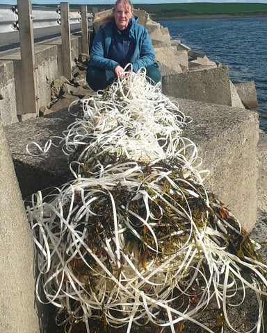 Alison gathers plastic waste from the ocean