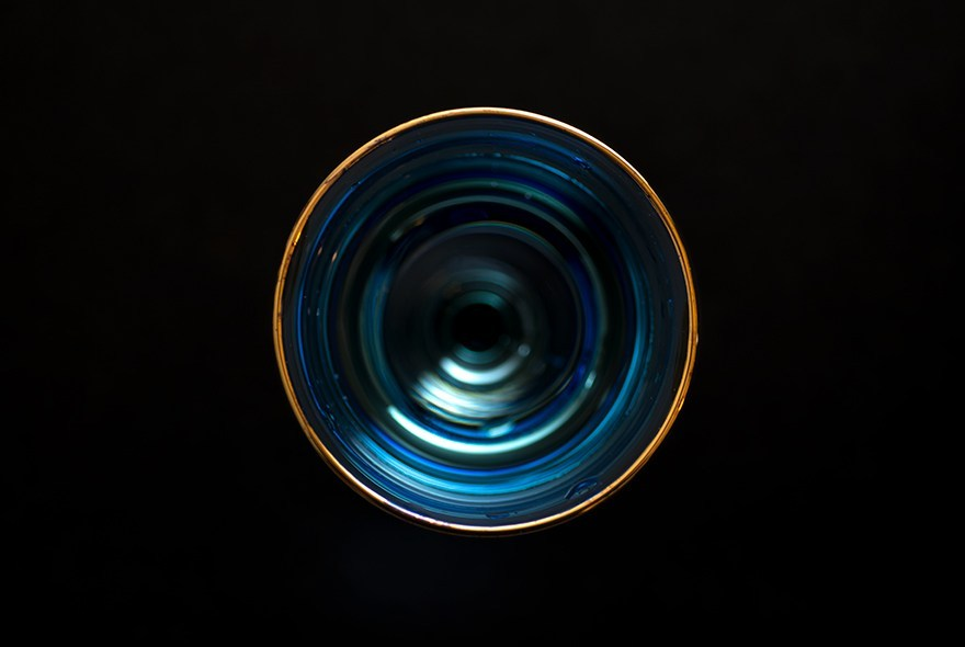 Blue glass with gold rim