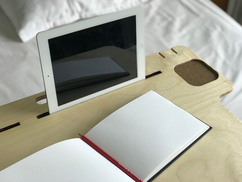 Ipad docked in the compact desk