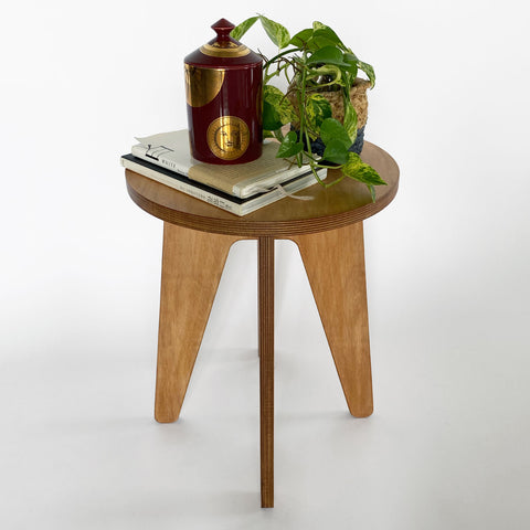 Keep stool with books on top